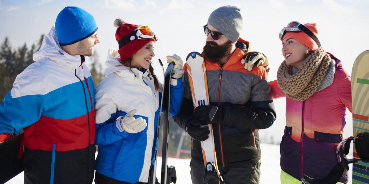 Group of friends having ski weekend